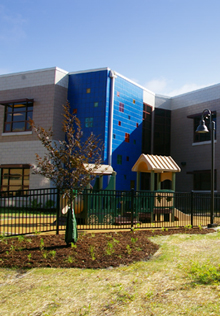 A multi-functional landscape, providing play space and aesthetics, at the Aurora Early Learning Center, a LEED Silver facility