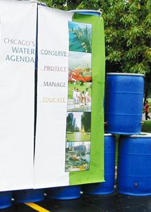 The rain barrels have advanced the Chicago Water Agenda, cited here on banners to help educate residents.